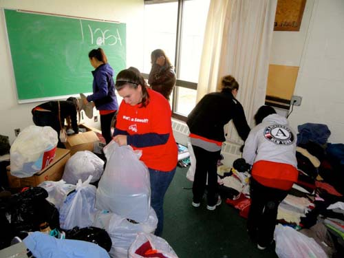 Stony Brook Students participate in relief efforts in Mastic Beach (photo courtesy of the Career Center).